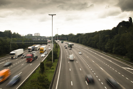 moving truck: The highway ring around Antwerp in Belgium with cars and speed signals