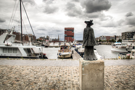 mas: The yacht harbour in the city of Antwerp, Belgium with a statue in the foreground and the MAS museum in the background Editorial