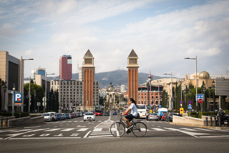 barsa: BARCELONA, SPAIN  CIRCA OCTOBER 2015: View over Placa de Espana with a guy on a bicycle from the Montjuic mountain in Barcelona in Spain Editorial
