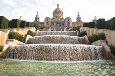 gothic build: Place de Espana with the fountain and on top of the stairs the magnificent Nation Museum in Barcelona in Spain