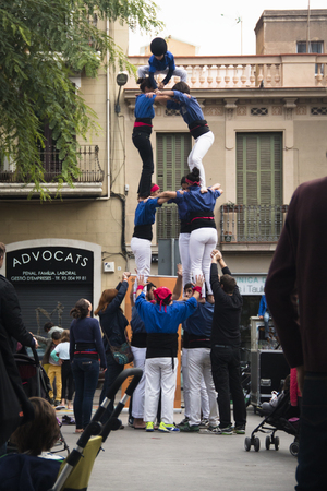 joining forces: BARCELONA, SPAIN  CIRCA OCTOBER 2015: People making a human pyramid in Barcelona in Spain