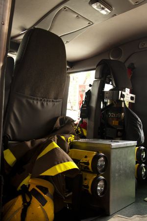 oxigen: The inside of a fire truck with oxigen tubes, flash lights and protective gear