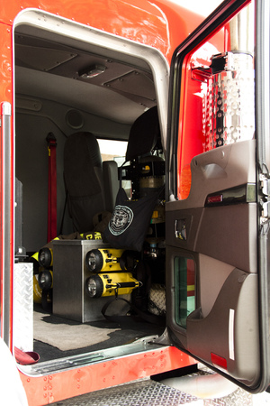 hoses: Overview of different tools inside a fire truck, like hoses, axes, flash lights