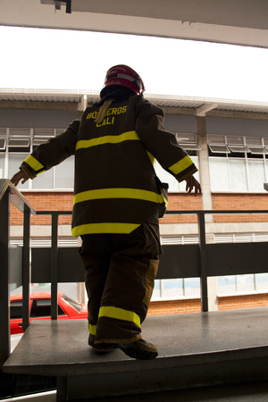 protective suit: back side of a fireman in protective suit of the fire department bomberos of Cali, Colombia