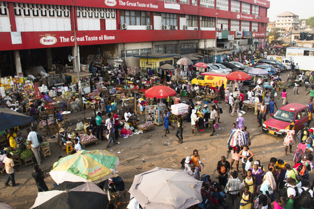 ACCRA, GHANA - JANUARY 2016: Outdoor goods stalls at Kaneshi market in Accra, Ghana