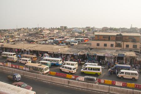 poorness: ACCRA, GHANA - JANUARY 2016: The bus and tro-tro station at Kaneshi market in Accra, Ghana