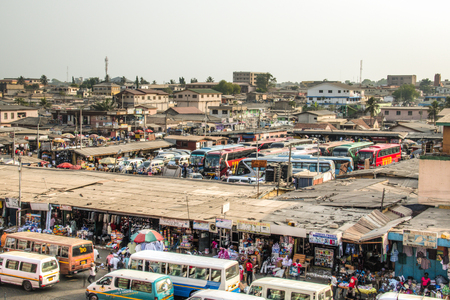 ACCRA, GHANA - JANUARY 2016: The bus and tro-tro station at Kaneshi market in Accra, Ghana
