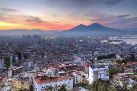 Sunrise over the city of Naples in Italy with the Visuvius volcano in the background