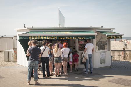 ice cream stand: KNOKKE, BELGIUM - MAY 2016: People waiting in queue at a stand of Australian ice cream in Knokke, Belgium