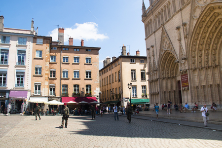 french renaissance: LYON, FRANCE - JULY 2016: Cosy public square with soldiers in the city of Lyon in France
