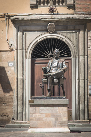 lucca: LUCCA, ITALY - JULY 2016: Historic square with a statue of Puccini in the cosy town Lucca in Tuscany, Italy
