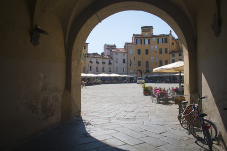 lucca: Gate to the romantic Piazza dell Anfiteatro square in Lucca in Italy Editorial