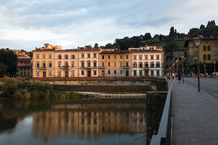 FLORENCE, ITALY - JULY 2016: Several historical buildings next to the Arno river near the city of Florence, Italy