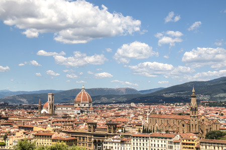 Magnificent view over the historical center of Florence in Italy. The photo is taken from piazzale Michelangelo and shows the Arno river, the Duomo and many other churches and buildings Stock Photo