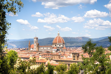 michelangelo: Magnificent view over the historical center of Florence in Italy. The photo is taken from piazzale Michelangelo and shows the Arno river, the Duomo and many other churches and buildings Stock Photo