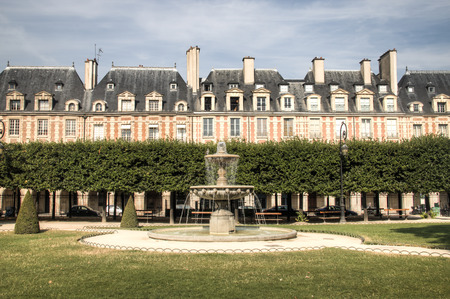 The famous place des Vosges square in Paris, France in said to be the most beautiful square in the city Фото со стока