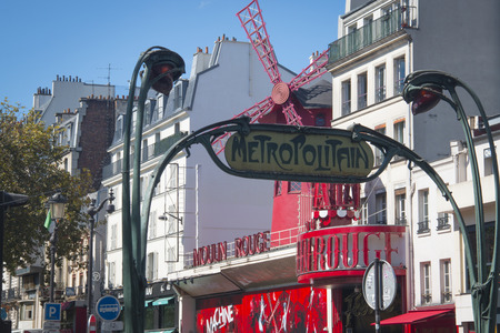 moulin: PARIS, FRANCE - SEPTEMBER 2016: The Moulin Rouge in Paris, France. The worlds most famous cabaret