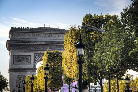 PARIS, FRANCE - SEPTEMBER 2016: The Arc de Triomphe in Paris, France half hidden behind the trees