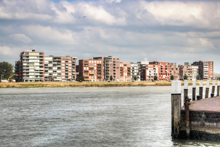 maas: View over the Maas river in Dordrecht, Netherlands with restaurants on the riverside Stock Photo