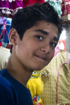CHITTAGONG, BANGLADESH - FEBRUARY 2017: Boy in the streets of Chittagong, the main port city of Bangladesh Editorial