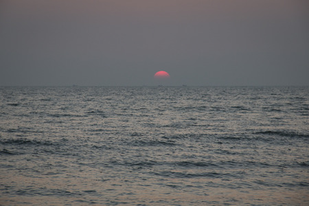 Sunset at the longest beach in the world in Coxs Bazar in Bangladesh Stock Photo
