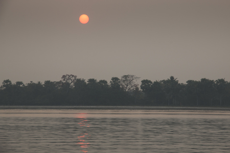 Sunset over the river in the Sundarbans national park, famous for its Royal Bengal Tiger in Bangladesh