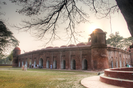 BAGERHAT, BANGLADESH - FEBRUARY 2017: Shait Gumbad Mosque in Bagerhat, Bangladesh, built in 1459 by Khan Jahan Ali. This mosque is also called the 60 dome mosque Redakční