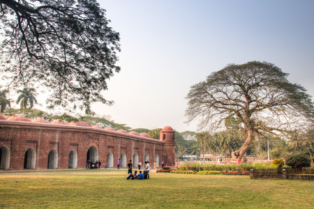 BAGERHAT, BANGLADESH - FEBRUARY 2017: Shait Gumbad Mosque in Bagerhat, Bangladesh, built in 1459 by Khan Jahan Ali. This mosque is also called the 60 dome mosque