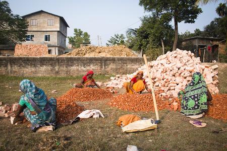 SRIMANGAL, BANGLADESH - FEBRUARY 2017: hard working women cutting stones in a village near Srimangal in Bangladesh