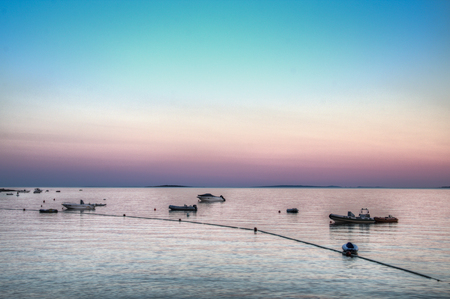 adriatico: Sunset at the habor in Cres village on Cres island in Croatia Stock Photo