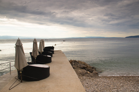mediteranean: Several chairs for tourists on a pier at the Adriatic coast in Lovran in Croatia