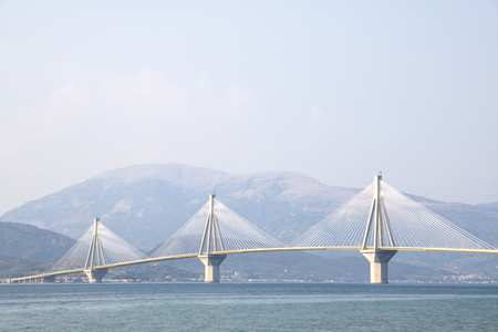 The Charilaos Trikoupis bridge between Antirrio and Rion in Greece seen from the beach in Rion