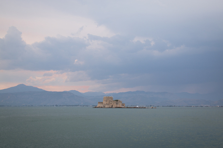 The Bourtzi water castle is a small island with a fortress at the coast of Nafplio in Greece
