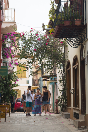 NAFPLIO, GREECE - SEPTEMBER 2017: A typical street with historical buildings in the ancient town Nafplio in Greece