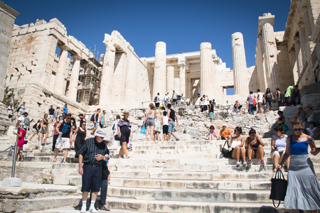 ATHENS, GREECE - SEPTEMBER 2017: People on the stairs at the entrance of the Acropolis in Athens, the capital of Greece