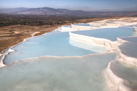 Beautiful landscape of the travertine pools and terraces in Pamukkale in Turkey