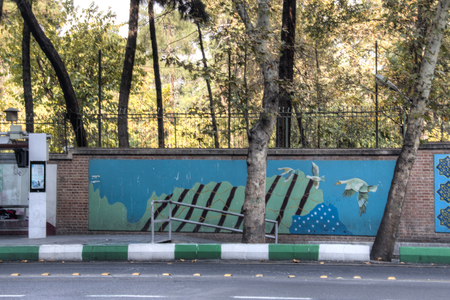 TEHRAN, IRAN – NOVEMBER 2017: Anti America propaganda at the former USA embassy in Tehran, the capital of Iran Editorial