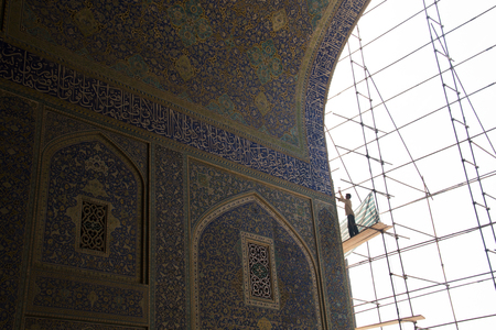 ISFAHAN, IRAN – NOVEMBER 2017: Restorations at the Shah mosque or Imam mosque on the Naqsh-e Jahan square in Isfahan, Iran