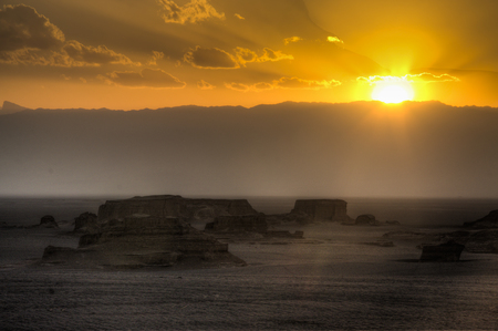 Sunset at the magnificent Dasht-e Lut deserts, famous for its rock formations called Kaluts or Kalouts near the city Kerman in Iran