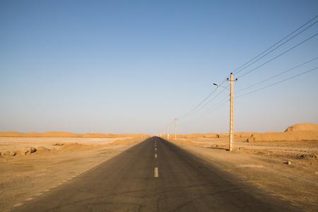 Empty mountain road going from Kerman towards the Dasht-e Lut desert in Iran