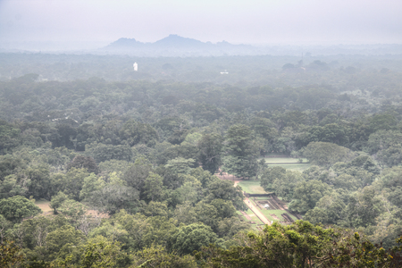 View over the jungle in Sigiriya in Sri Lanka from the top of the famous Lion's rock. Stock Photo