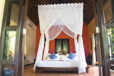 Fancy hotel room with towels folded like swans in Pemuteran in Bali, Indonesia
