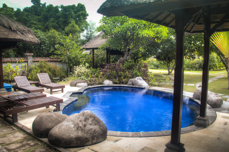 Fancy hotel room with private swimming pool in Pemuteran in Bali, Indonesia Фото со стока - 120167998