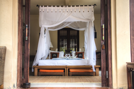 Fancy hotel room with towels folded like swans in Pemuteran in Bali, Indonesia