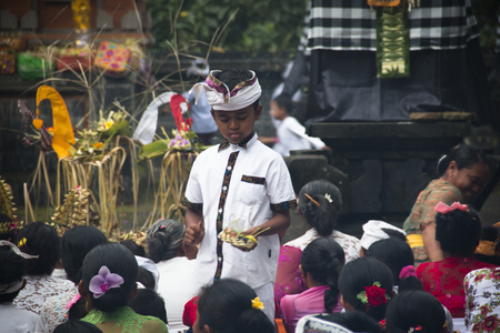 SIDEMEN, BALI - JANUARY 2018: A Hindu ceremony with offerings and many visitors in Bali, the most touristic island of Indonesia
