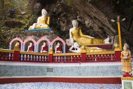 Buddha statues in the Bayin Nyi cave in Hpa-An in Myanmar Фото со стока - 120168076