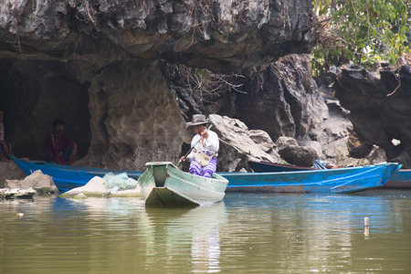 HPA-AN, MYANMAR – MARCH 2018: Boats on the lake next to the Sadan cave near Hpa-An in Myanmar