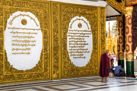 YANGON, MYANMAR – MARCH 2018: The impressive golden Shwedagon Pagoda is one of the most famous temples in Yangon, the capital of Myanmar