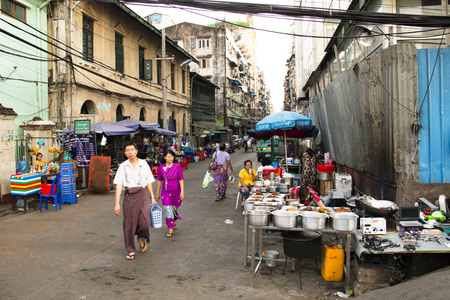 YANGON, MYANMAR – MARCH 2018: View over a busy street in Yangon, the capital of Myanmar Фото со стока - 120168079