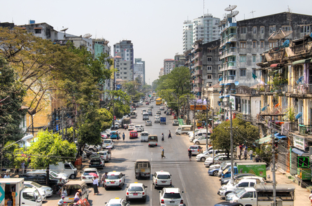YANGON, MYANMAR – MARCH 2018: View over a busy street in Yangon, the capital of Myanmar Фото со стока - 120168060